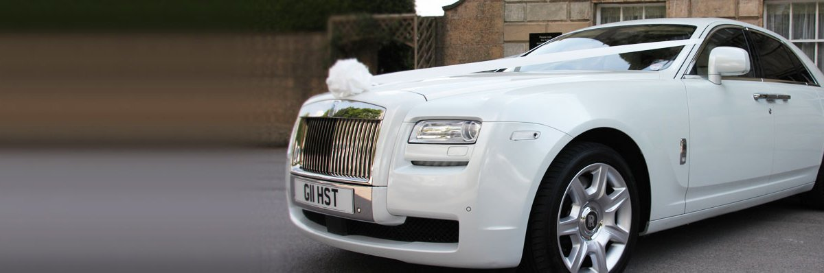 Pearl white Rolls Royce Ghost wedding car
