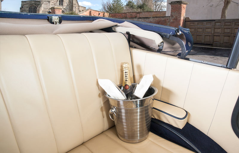 wine bucket in the back seat of the Badworth car