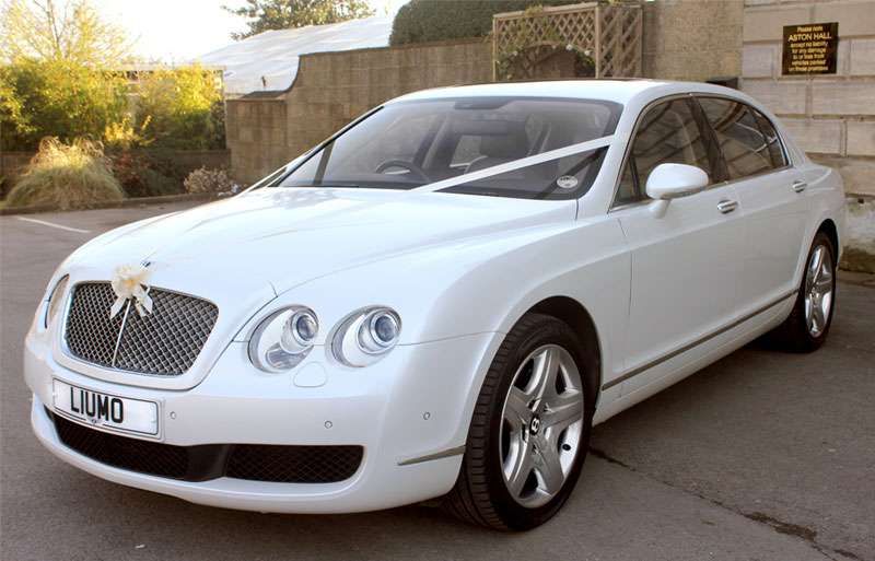 Bentley Continental Flying Spur in all it's glory outside wedding venue