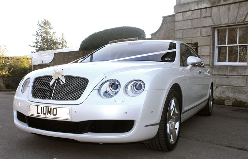 Perl white Wedding car set up with ribbon