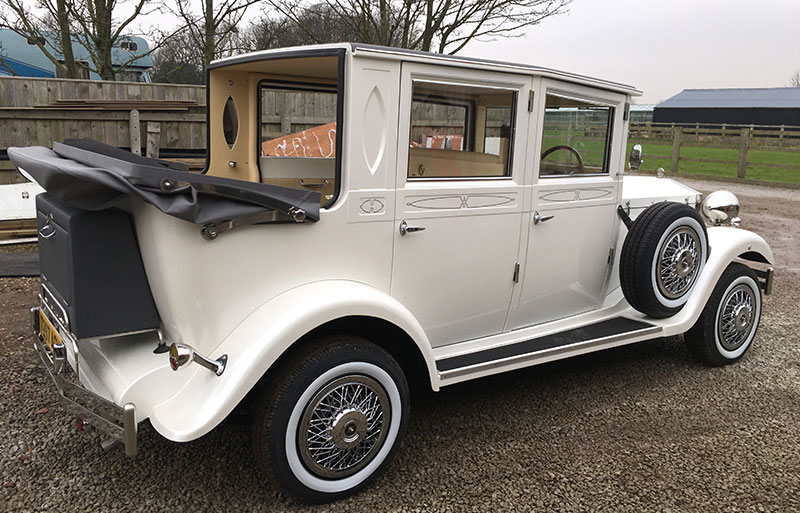 The classic vintage wedding car sat outside the church