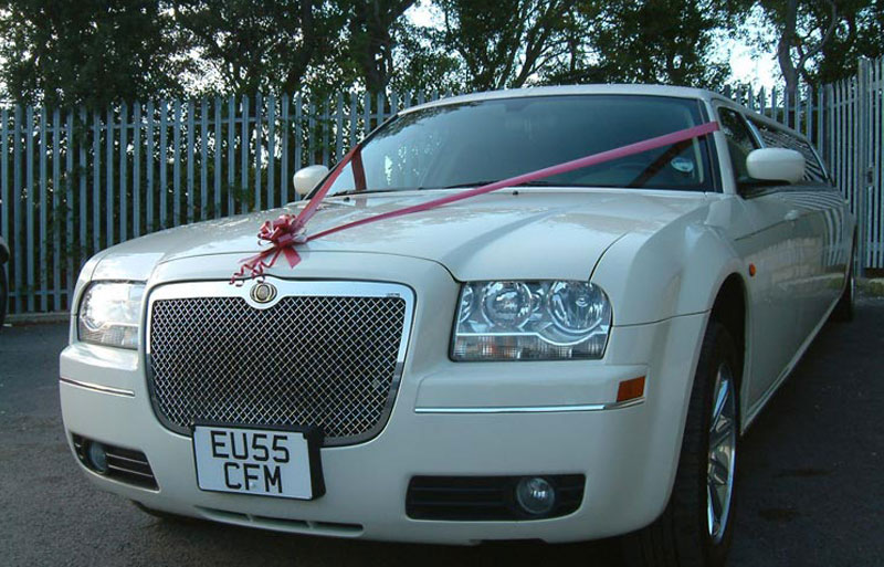 Front photo of the Ivory white wedding limo