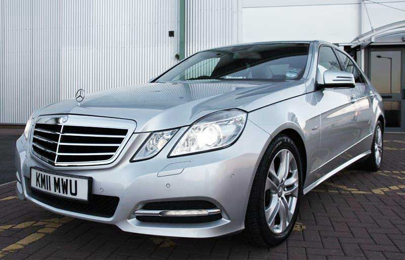 Mercedes E Class with wedding ribbon
