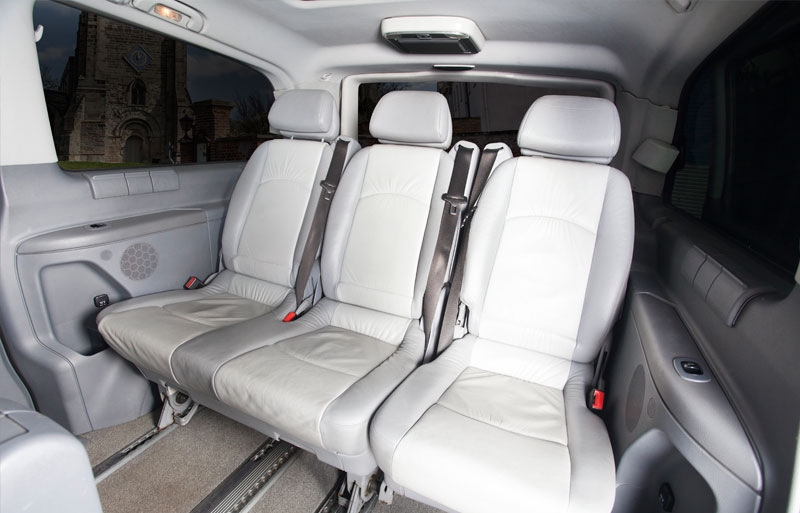 The 3 back seats of showing the inside of the Viano