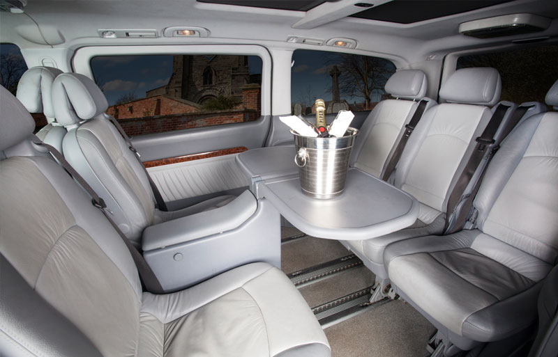 Back seat of the Mercedes with table and champagne on show