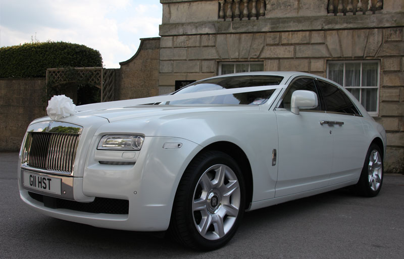 The Rolls Royce Ghost with wedding ribbon