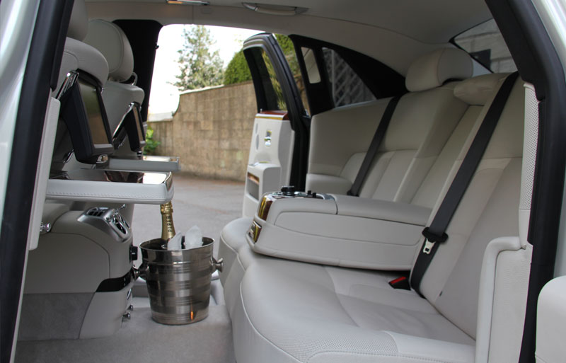 Interior photo displaying wedding bucket of the White Rolls Royce Ghost