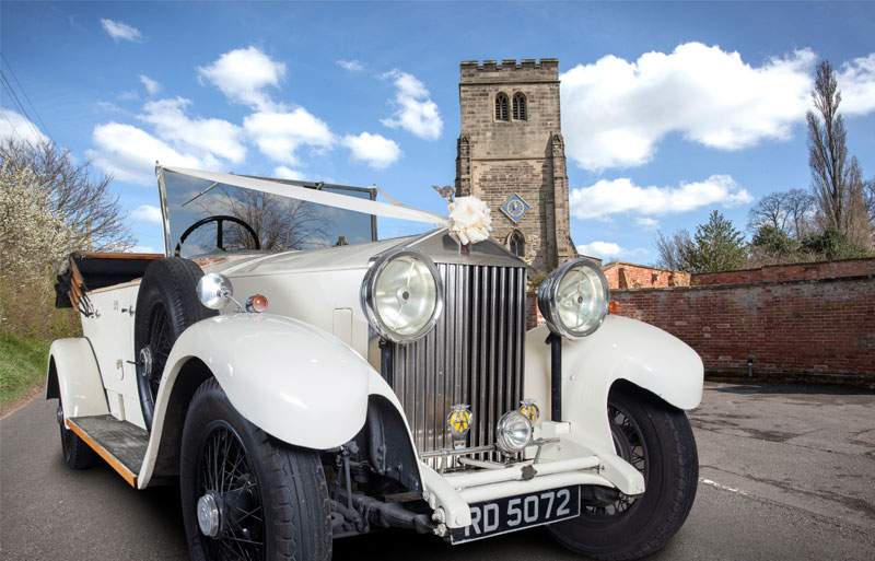 Rolls Royce Open Tourer in front of a church