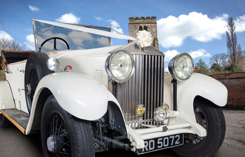 Vintage Rolls Royce with wedding ribbon