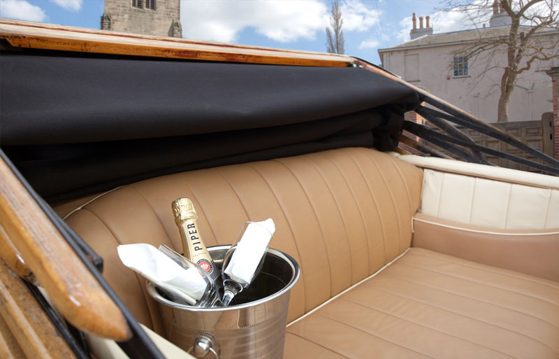 Wine bucket on the seat of the Rolls Royce