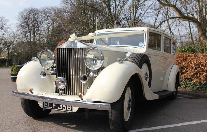 Vintage Rolls Royce outside church