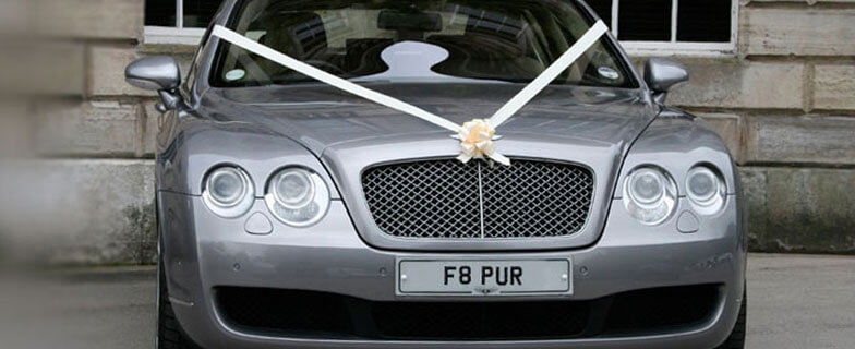 Silver Bentley continental wedding car